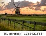 windmill in holland | Shutterstock . vector #1163421565