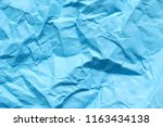 a rumpled bright blue paper... | Shutterstock . vector #1163434138