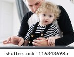young good father teaches his... | Shutterstock . vector #1163436985