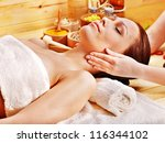 woman getting  massage in... | Shutterstock . vector #116344102