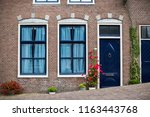traditional dutch house in edam | Shutterstock . vector #1163443768