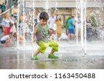 excited boy having fun between... | Shutterstock . vector #1163450488