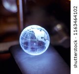 earth globe lit up  | Shutterstock . vector #1163464102
