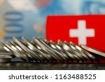 there are various swiss coins... | Shutterstock . vector #1163488525