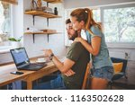 young couple working on laptop  ... | Shutterstock . vector #1163502628