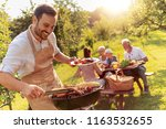 happy family having barbecue... | Shutterstock . vector #1163532655