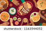 family celebrating diwali at... | Shutterstock .eps vector #1163544052