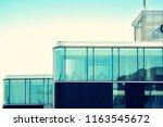 modern office building on a...   Shutterstock . vector #1163545672