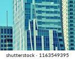 modern office building on a...   Shutterstock . vector #1163549395
