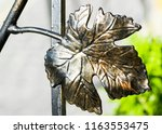 the fragment of forged metal... | Shutterstock . vector #1163553475