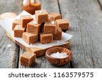 salted caramel pieces and sea... | Shutterstock . vector #1163579575