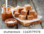 salted caramel pieces and sea... | Shutterstock . vector #1163579578