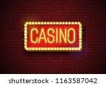 casino neon sign illustration...   Shutterstock . vector #1163587042