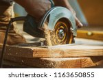 Close Up Of A Carpenter Using ...