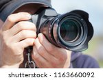 male photographer with a large... | Shutterstock . vector #1163660092