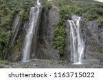 franz josef glacier  waterfall...   Shutterstock . vector #1163715022