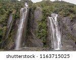 franz josef glacier  waterfall...   Shutterstock . vector #1163715025