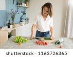 woman preparing salad in the... | Shutterstock . vector #1163726365