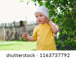 small curious kid standing near ... | Shutterstock . vector #1163737792