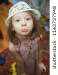 girl with a funny face looking... | Shutterstock . vector #1163737948