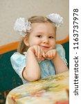 cute smile little girl sitting... | Shutterstock . vector #1163737978