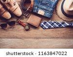 clothing for men on the wooden... | Shutterstock . vector #1163847022