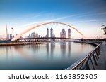 colorful sunset over dubai... | Shutterstock . vector #1163852905