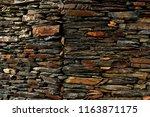 black wall  slate stone  of a...   Shutterstock . vector #1163871175