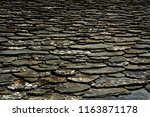 roof with slate tiles of a...   Shutterstock . vector #1163871178