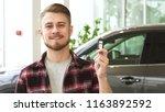 happy young handsome bearded... | Shutterstock . vector #1163892592
