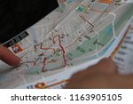 a tourist exploring the map in... | Shutterstock . vector #1163905105