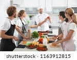 group of people and male chef... | Shutterstock . vector #1163912815