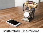new and old telephone on the... | Shutterstock . vector #1163939065