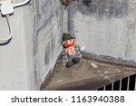 lost rag doll street dirty...   Shutterstock . vector #1163940388