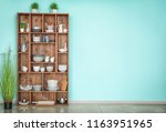 kitchen shelving with dishes on ... | Shutterstock . vector #1163951965