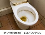 dirty unhygienic toilet bowl... | Shutterstock . vector #1164004402