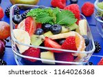 colorful fruit salad in a... | Shutterstock . vector #1164026368