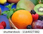 mix of colorful fruits in a... | Shutterstock . vector #1164027382