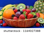 fresh fruits in a basket on... | Shutterstock . vector #1164027388