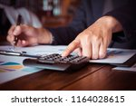 asian businessman or accountant ... | Shutterstock . vector #1164028615