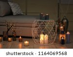 cozy room decorated with... | Shutterstock . vector #1164069568