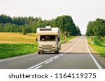camper rv on the road in warsaw ... | Shutterstock . vector #1164119275