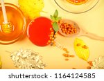 tea with sea buckthorn stands... | Shutterstock . vector #1164124585