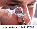 close up of a male jeweler's... | Shutterstock . vector #1164147802
