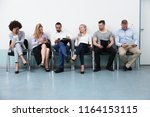 candidates sitting on chair... | Shutterstock . vector #1164153115