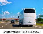 bus on the road in poland. | Shutterstock . vector #1164165052