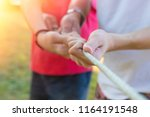 group of hands pulling rope | Shutterstock . vector #1164191548