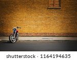retro motorcycle parked in... | Shutterstock . vector #1164194635