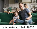 happy dad and kid son holding... | Shutterstock . vector #1164198358