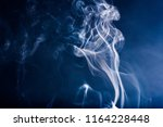 smoke on blackbackground | Shutterstock . vector #1164228448